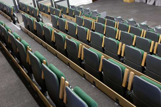 Folded chairs in student theatre