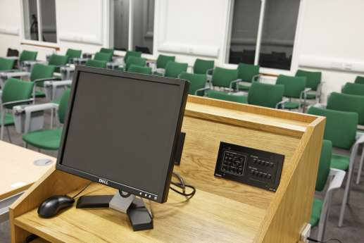 Computer overlooking lecture theatre seating