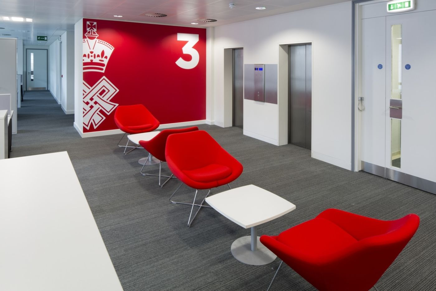 Red wall and furniture in designer office fit out