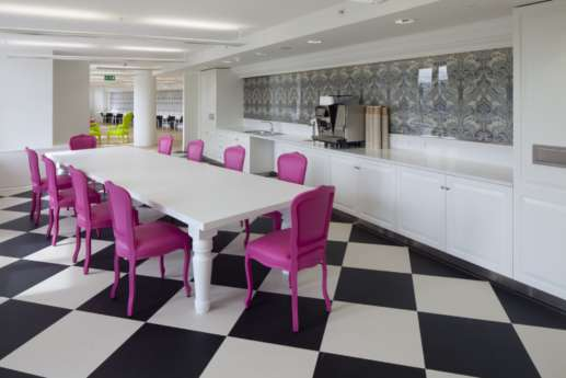 Bright pink chairs in kitchen area