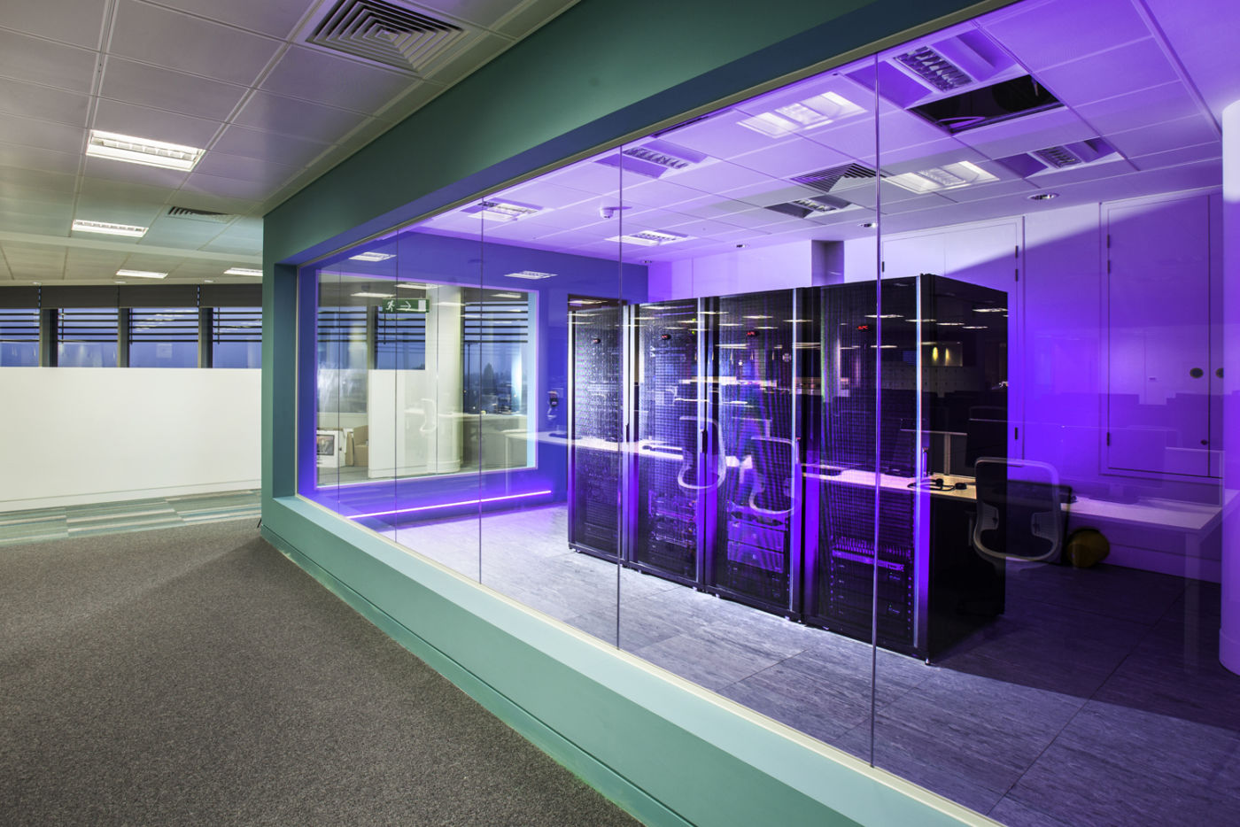 IT mainframe and server in an open plan office fit out with purple lighting