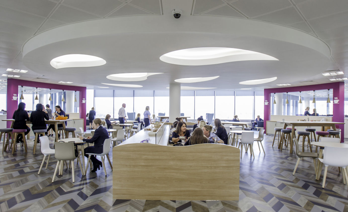 Busy staff cafeteria with funky flooring in a modern office fit out