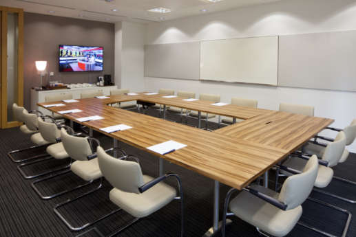 Large square table in meeting room