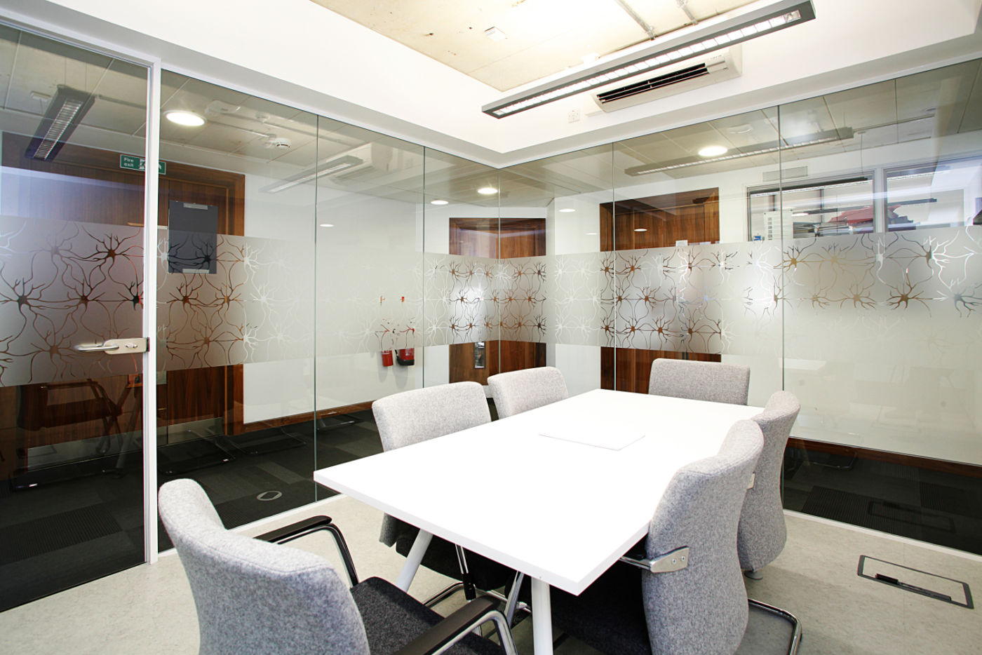 Glass screen surrouding meeting room