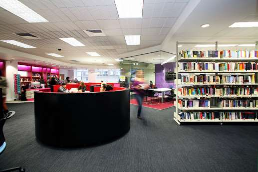 Curved sofas in library fit out
