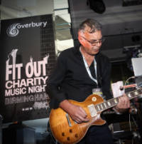 Guitarist at fit out music night