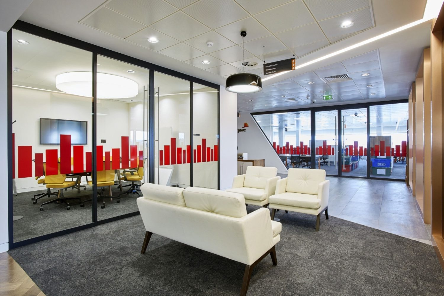 PwC white sofas in breakout space