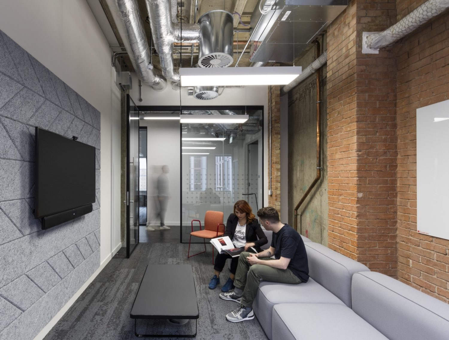 Rocketspace breakout area with exposed services