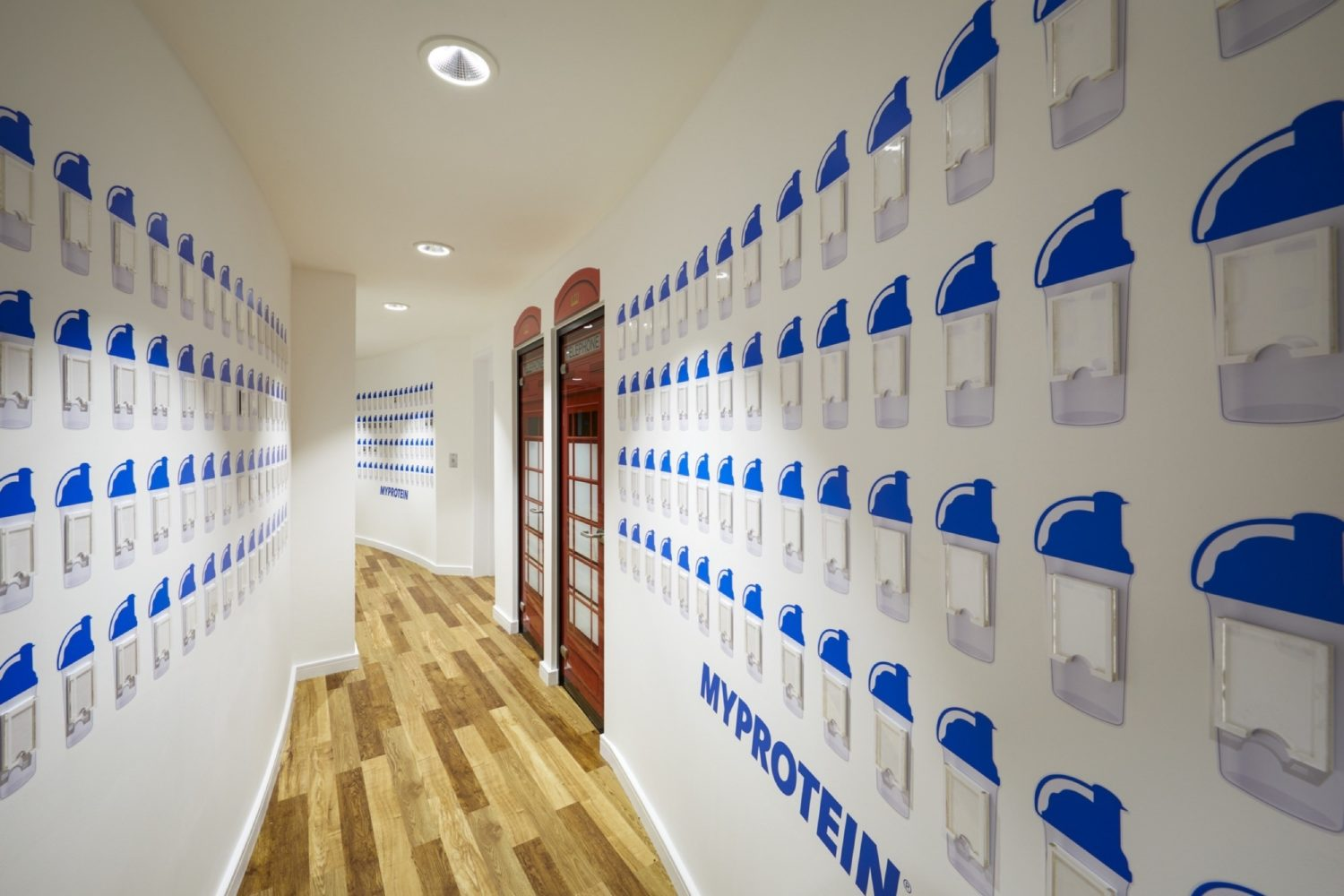 MyProtein shakers in curved hallway