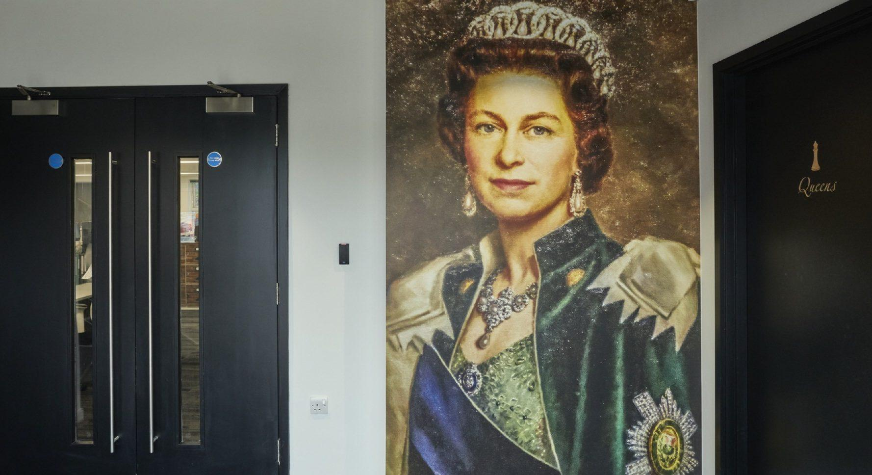 The Hut group Queen print in office fit out