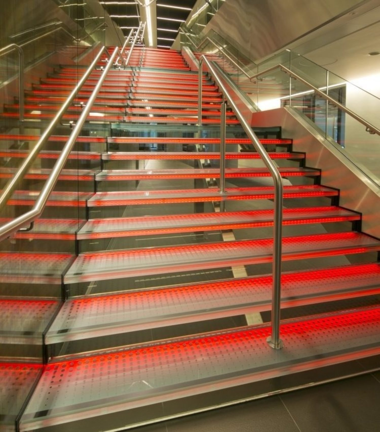 Aon staircase lit in red